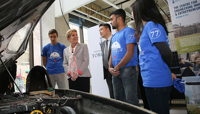 Kathleen Wynne and students from the Blue Sky Solar Racing team