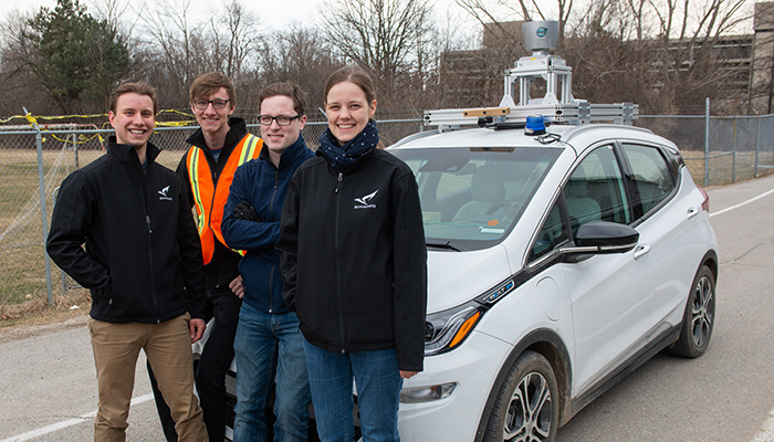 aUToronto team members Zachary Kroeze, Andreas Schimpe, Keenan Burnett (EngS and Mona Gridseth in front of their autonomous vehicle, dubbed Zeus