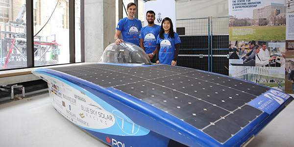 Members of U of T Engineering's BLUE Sky Solar Racing team show off Polaris, the vehicle that placed 11th in the Challenger Class of the 2017 World Solar Challenge through the Australian Outback.