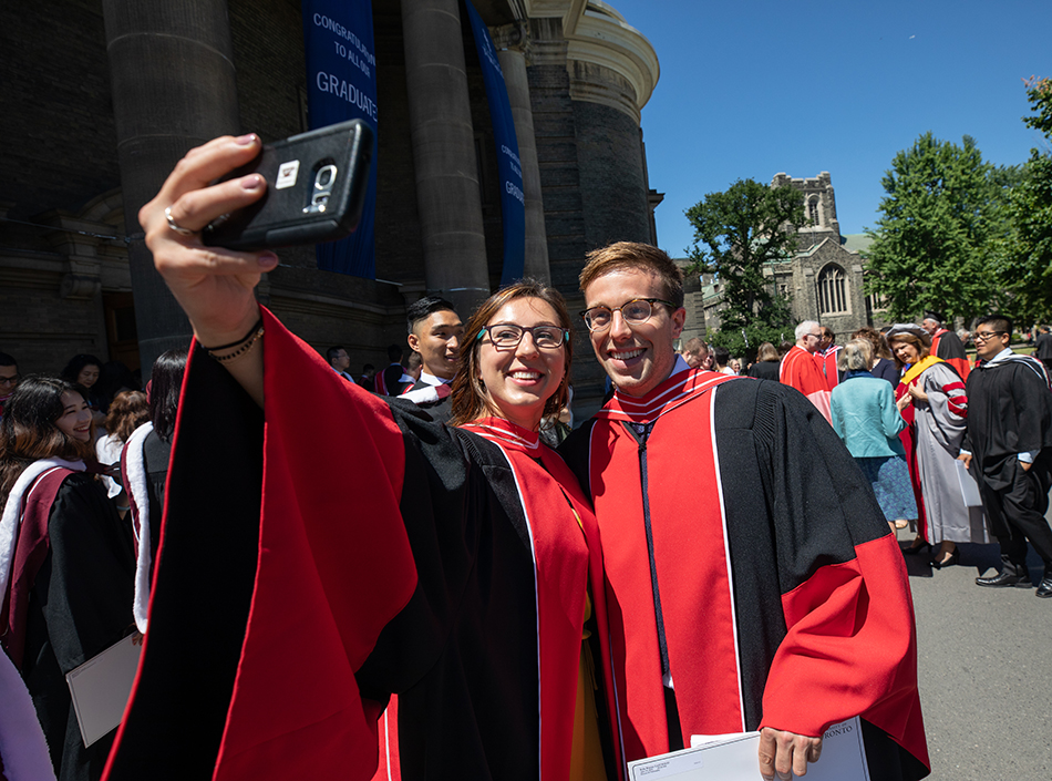 Students celebrating outside of Convocation Hall, University of Toronto