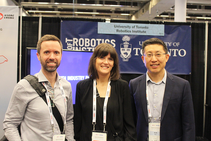 The Robotics Institute will be led by Professor Yu Sun (MIE), far right, and will include faculty members Tim Barfoot (UTIAS), who will lead the autonomous field robotics pillar, and Professor Angela Schoellig (UTIAS). (Photo courtesy of the Robotics Institute)