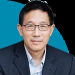 headshot of Chris Yip on blue semi-circle background