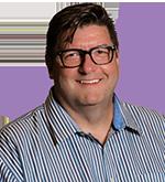 headshot of Gary Saarenvirta on purple semi-circle background